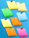 Sticky squares of different colors with pins colorful paper yellow blue orange pink green or stickies pinned on blue bulletin Stock Image