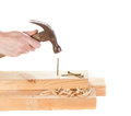 Stiking a nail with a hammer Royalty Free Stock Photo