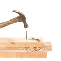 Stiking a nail with a hammer Royalty Free Stock Image