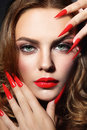 Stiletto nails close up portrait of young beautiful woman with red lipstick and long Stock Photos