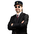 Stilish man in gendarme stile hat and in sunglasses smiling Royalty Free Stock Image
