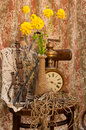 Still life with antique clock and yellow flowers Stock Images