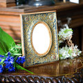 Still life with antique ornate frame. Royalty Free Stock Photos