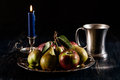 Still life with apples and pears dark light Royalty Free Stock Photography