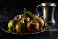 Still life with apples and pears dark light Stock Images