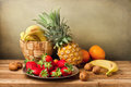 Still life assorted fruits wooden table Royalty Free Stock Image