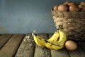 Still life with banana and eggs on wood table background Royalty Free Stock Photography