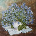 Still life with beautiful Forget-me-not bouquet in ceramic vase. Blue spring flowers `forget me not` Myosotis in