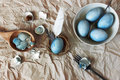 Still life with blue easter eggs with cutlery unusual version painted hibiscus Stock Photos