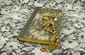 Still life with a book and a rosary Royalty Free Stock Photo
