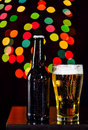 Still life, Bottles of beer and glass getting cool on bokeh bac Royalty Free Stock Photo