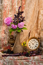 Still life bouquet with antique clock and pink hydrangea Royalty Free Stock Image