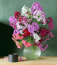 Still life with bouquet of pink Phlox in the clear jug Royalty Free Stock Photo
