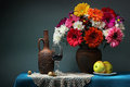 Still life with a bouquet and wine. Transvaal daisies. Royalty Free Stock Photo