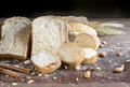 Still life with bread and wheat on wooden table Royalty Free Stock Photo