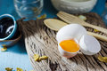 Still life broken white eggs and egg yolk Royalty Free Stock Photo