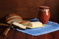 Still life butter bread milk Stock Images
