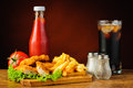 Still life with chicken nuggets and french fries fast food menu cola tomato ketchup Stock Photo