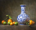 Still life with chinese vase and fruit Royalty Free Stock Images