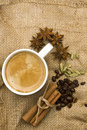 Still life of coffee and spices cup on a piece burlap beans Royalty Free Stock Photography
