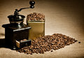 Still life coffee of the wooden old grinder stand in great plenty of in grains close up Royalty Free Stock Images