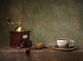 Still life with cup of coffee and grinder Stock Images
