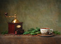 Still life with cup of coffee and grinder on stone table Royalty Free Stock Photo