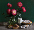 Still life with dahlias, thin captain and milk Royalty Free Stock Photography