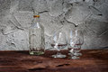 Still life with differently shaped glass bottles on wooden table Royalty Free Stock Photos