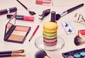 Still life of fashion woman essentials cosmetics beauty makeup accessories macarons french dessert lipstick brushes eyeshadow Royalty Free Stock Photos