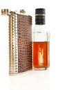 The still life from flask and bottle with cognac on white background Royalty Free Stock Image