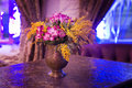 Still life. Flower in vase on table. In restaurant at night. Royalty Free Stock Photo