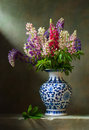 Still life with flowers lupine in a chinese vase Stock Image
