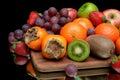 Still life of fresh fruit on a black background Royalty Free Stock Photo