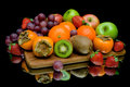 Still life of fruit on a black background Royalty Free Stock Photo