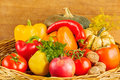 Still life with fruit and vegetables in a wicker basket Royalty Free Stock Photography