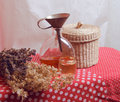 Still life with funnel and tincture herbs wicker basket Royalty Free Stock Photos