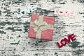 Still life of gift box on grunge wood background Royalty Free Stock Photo