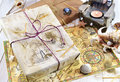 Still life with gift and hand drawn pirate map Royalty Free Stock Photo