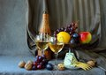 Still life gifts of autumn two glasses wine cheese and ripe fruit Stock Photos