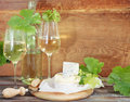 Still life with glasses of white wine bottle and cheese Stock Photo