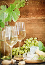Still life glasses white wine bottle chesse Stock Images