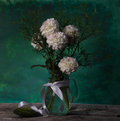 Still life of in grunge style with a bouquet flowers Stock Photos