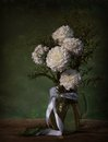 Still life of in grunge style with a bouquet flowers Royalty Free Stock Images