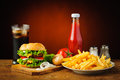 Still life with hamburger menu french fries cola drink tomato ketchup salt and pepper Royalty Free Stock Photography