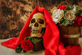 Still life with human skull with red rose and white rose