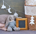 Still life with interior Christmas decoration elements and rabbit toy Royalty Free Stock Photo