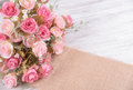 still life interior decoration pink rose flower on rustic wooden Royalty Free Stock Photo