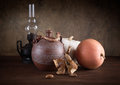 Still-life with a jug an oil lamp and pumpkins Stock Photos
