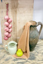 Still life with jug and red onions Royalty Free Stock Photo